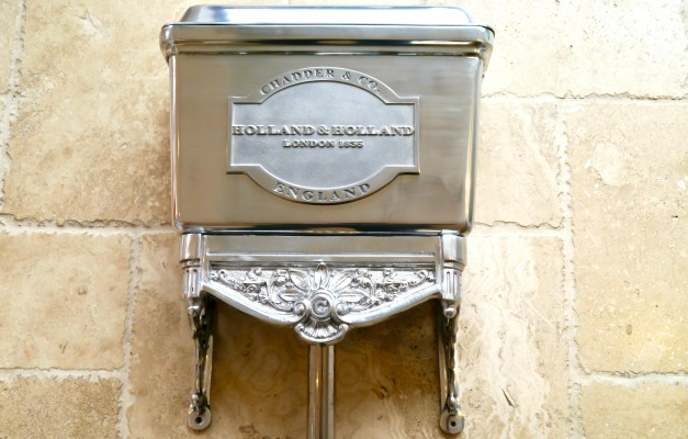 polished metal antique style toilet cistern with bespoke holland and holland chadder plaque
