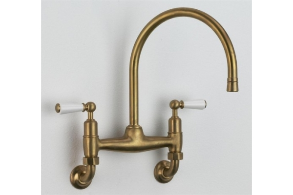 Weathered Brass/ Antique Brass Wall mounted Ang Kitchen Mixer with white lever handles.