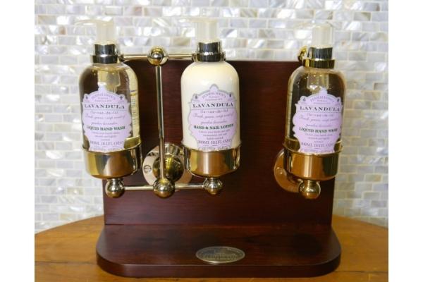 Lockable Soap bottle Holders. Designed for Penhaligon's soap bottles. Luxury Brass soap bottle holders in Nickel finish.
