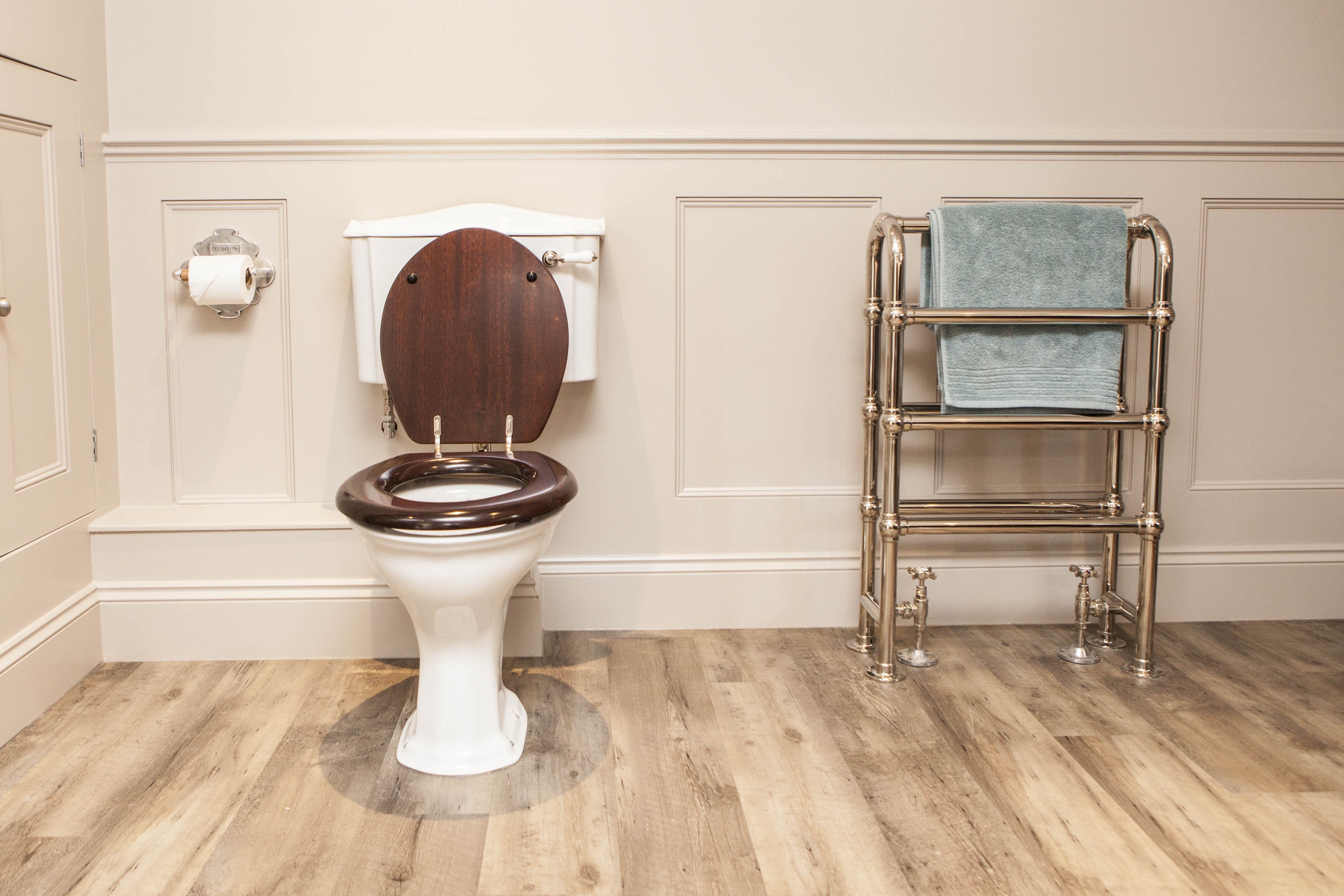 traditional low level toilet with mahogany seat