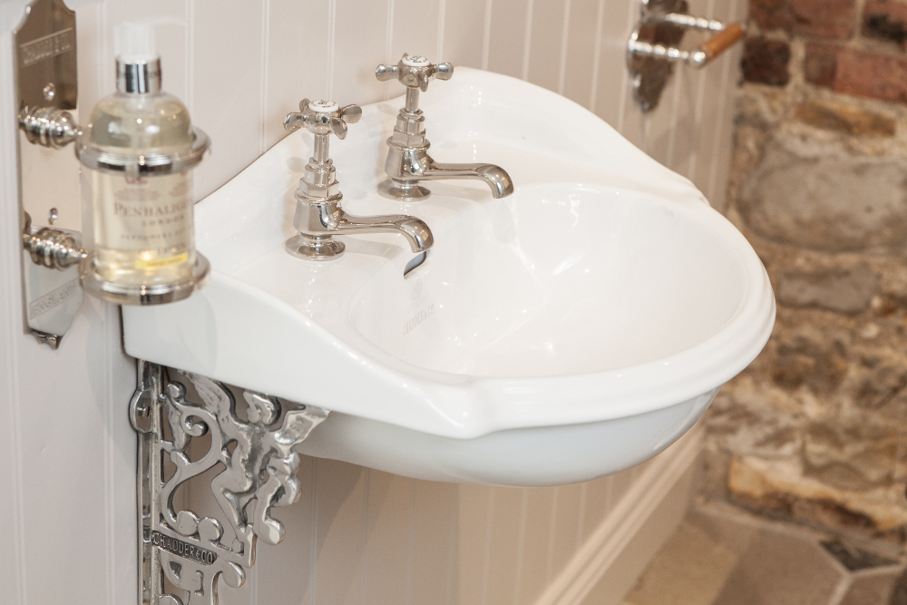 traditional luxury cloakroom basin from chadder and co with metal fretwork and classic taps