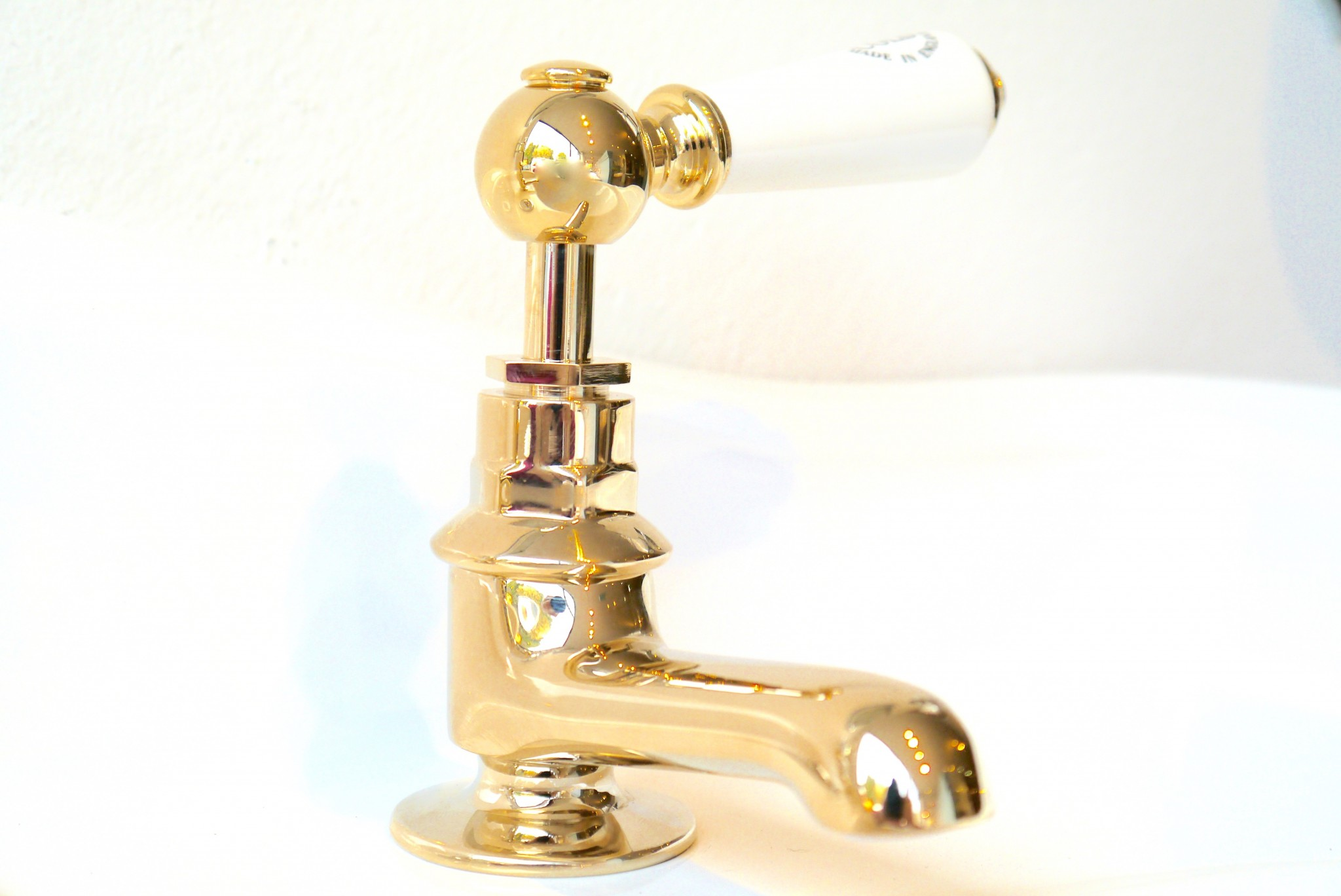 C230 Basin Tap in Gold Plate finish with White leavers.