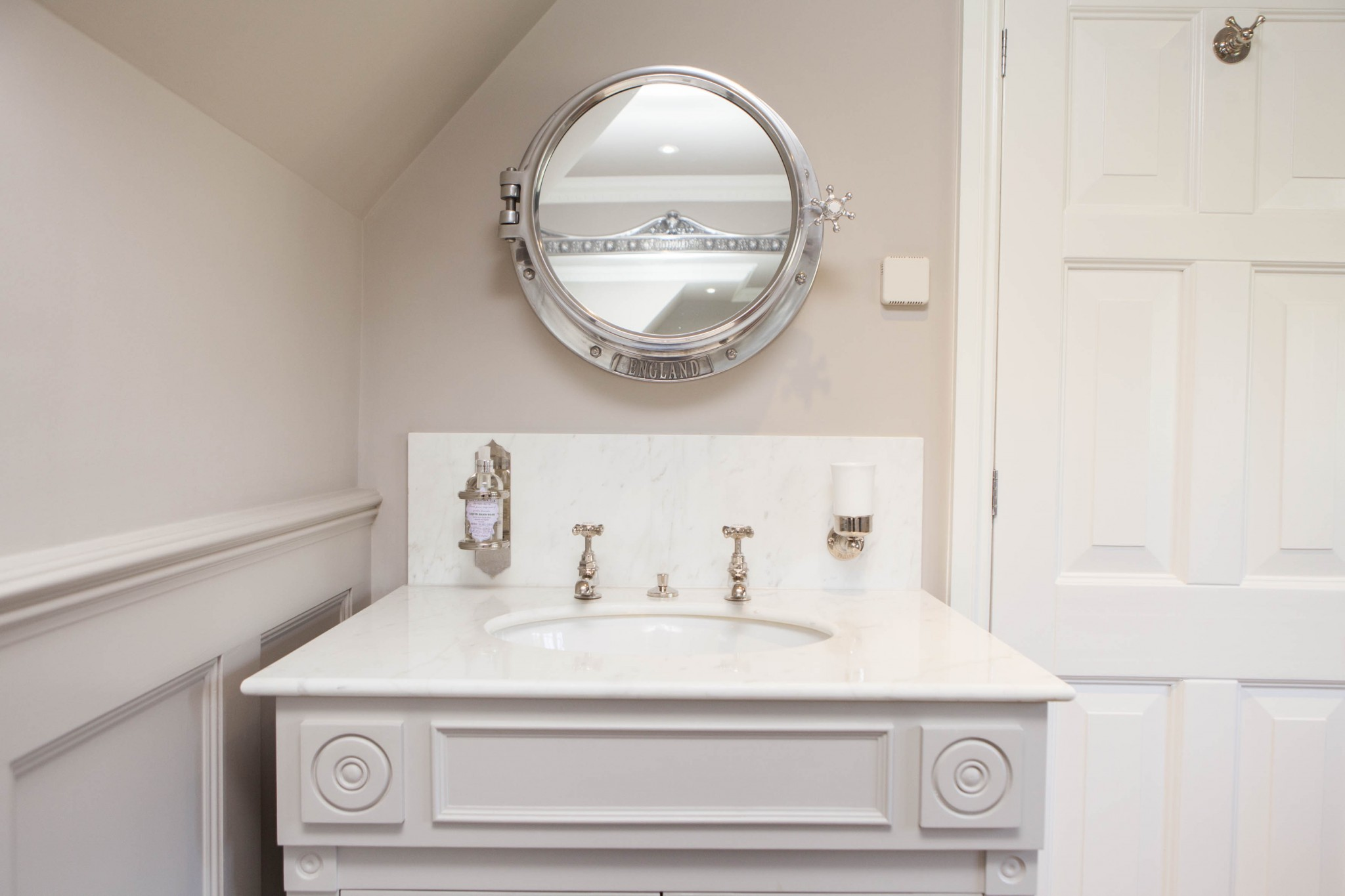 Chadder Windsor Basin cabinet with Chadder Porthole Mirror cabinet above with nickel fittings.