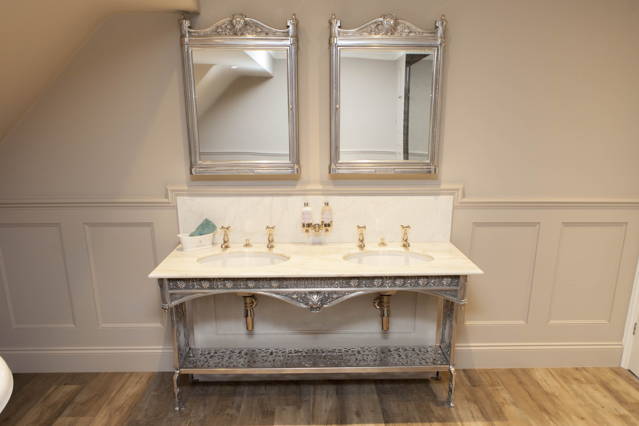 Chadder Coronation double basin unit with marble top and Nickel fittings. Chadder Blenheim surface mounted cabinets above.