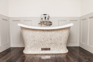 Chariot Bath with Mother of Pearl Mosaic Exterior.