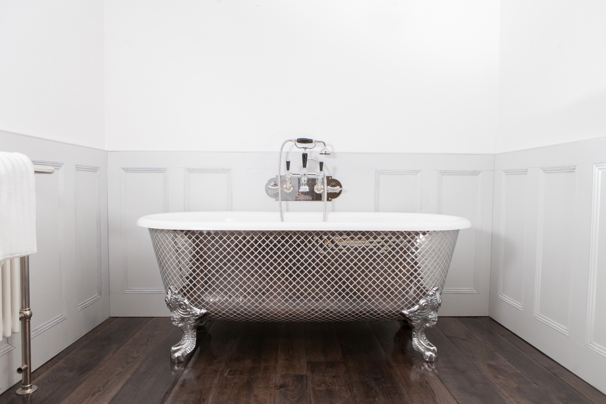 Blenheim Bath with Polished Metal Mosaic Exterior.