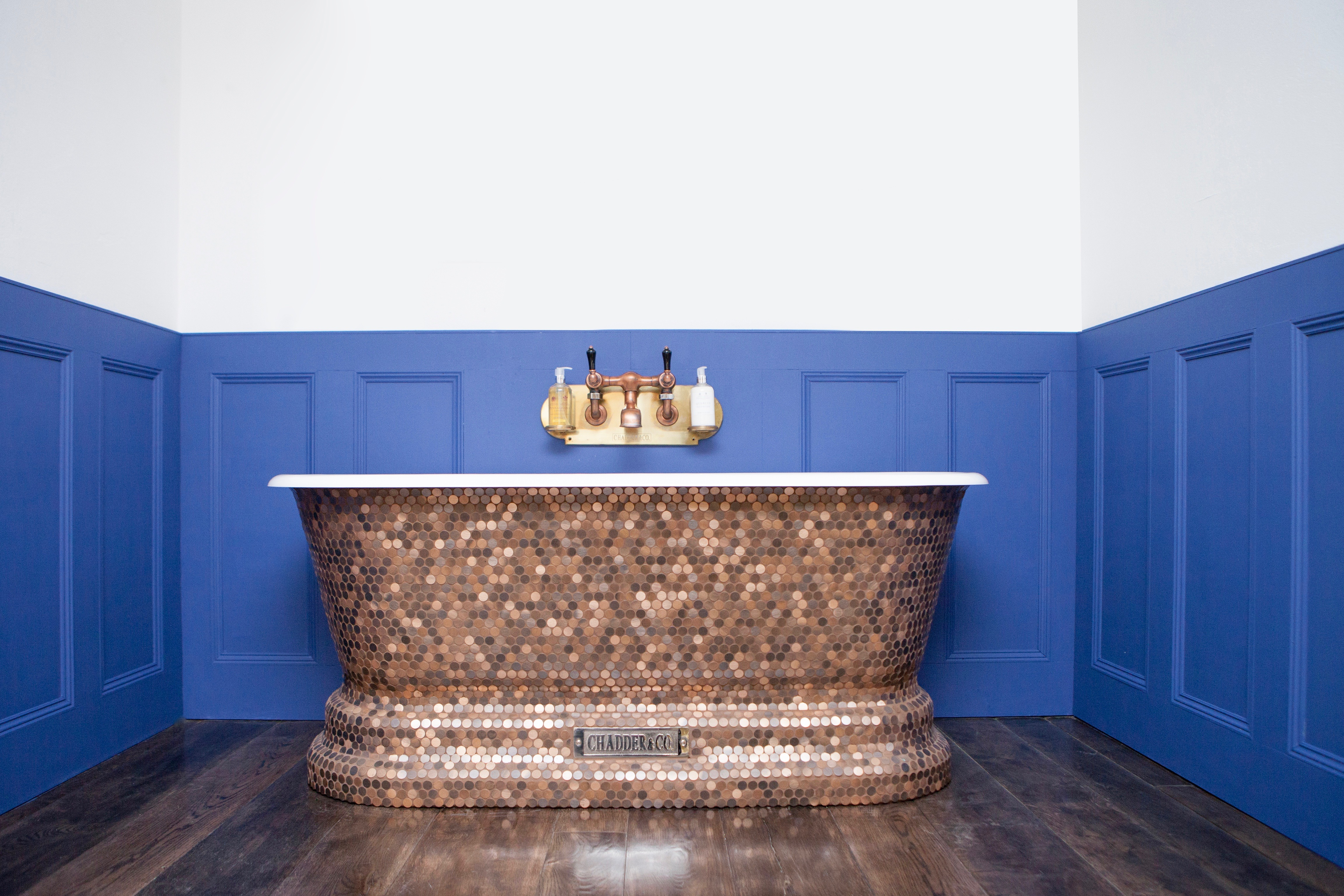 Pennies from Heaven, Windsor Bath with round copper mosaic exterior.