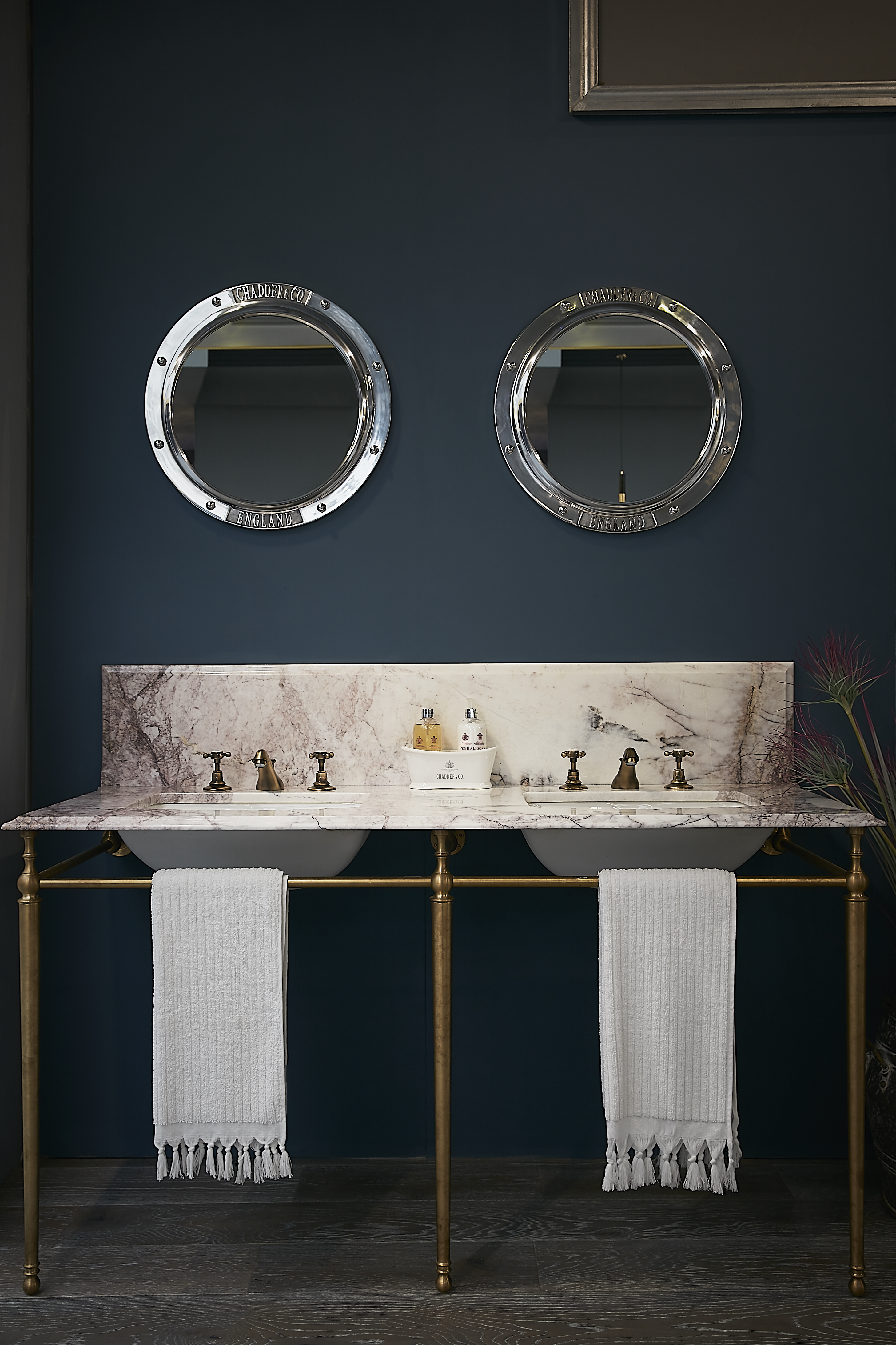 double basin vanity unit with marble top porthole mirrors