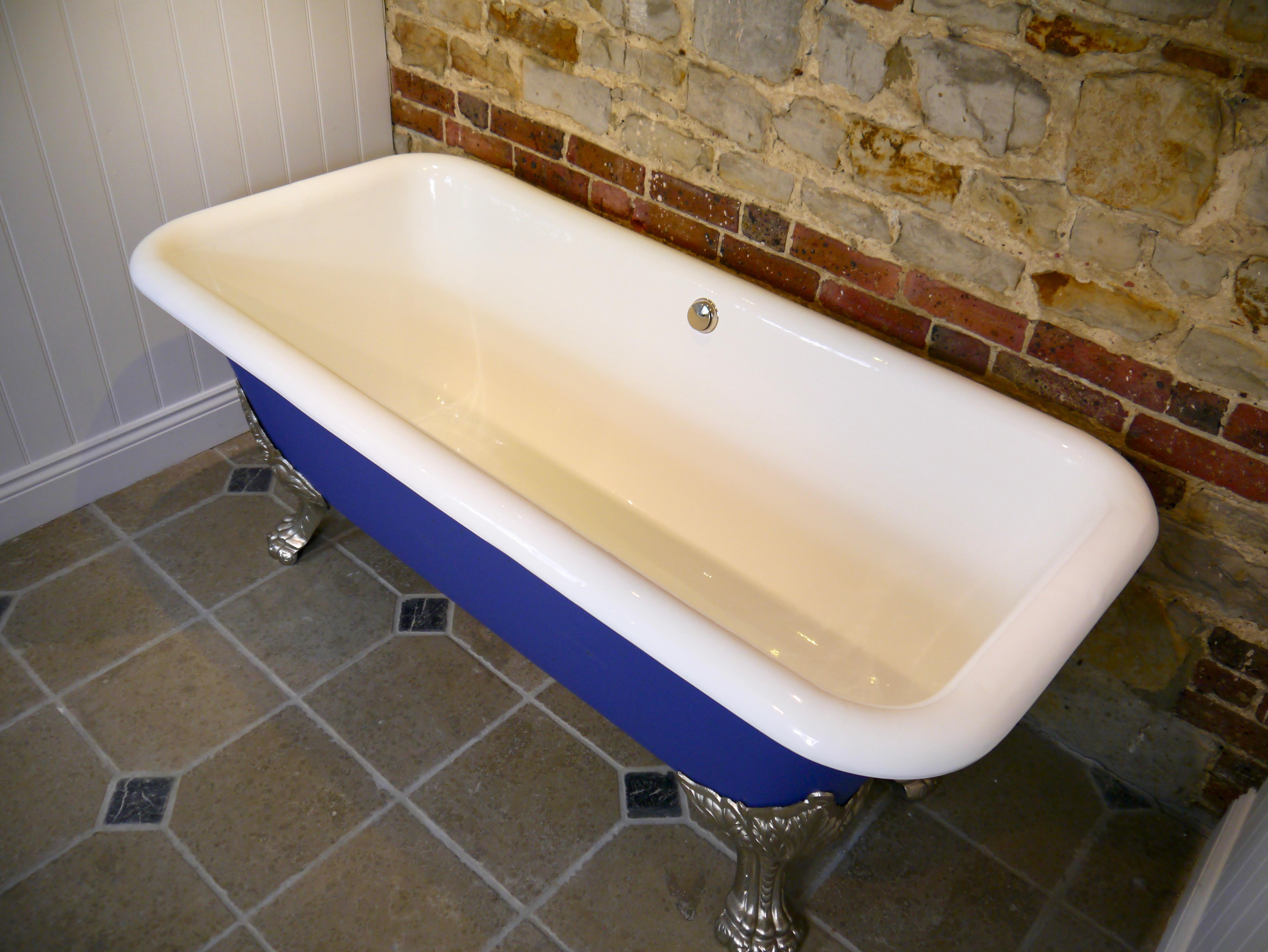 exposed brick wall cast iron bath bath enamelling