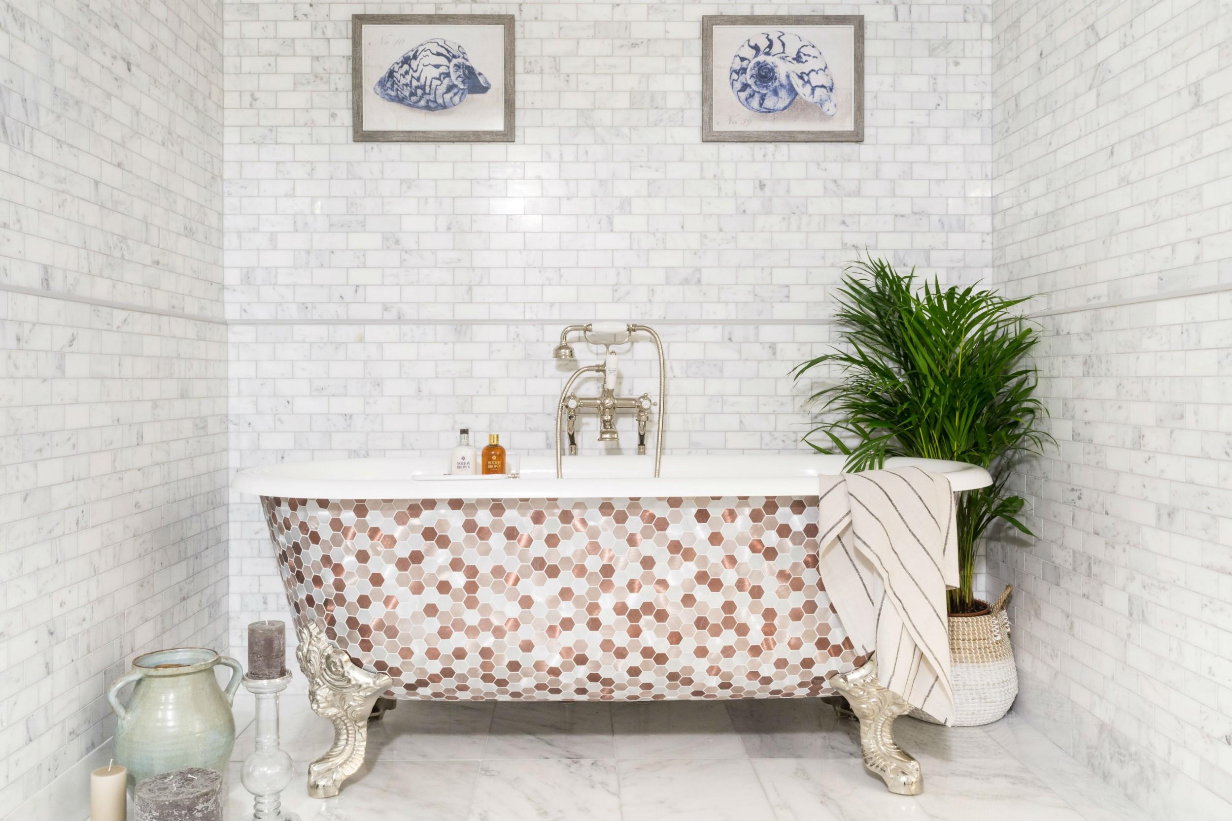 free standing bathtub with metal mosaic