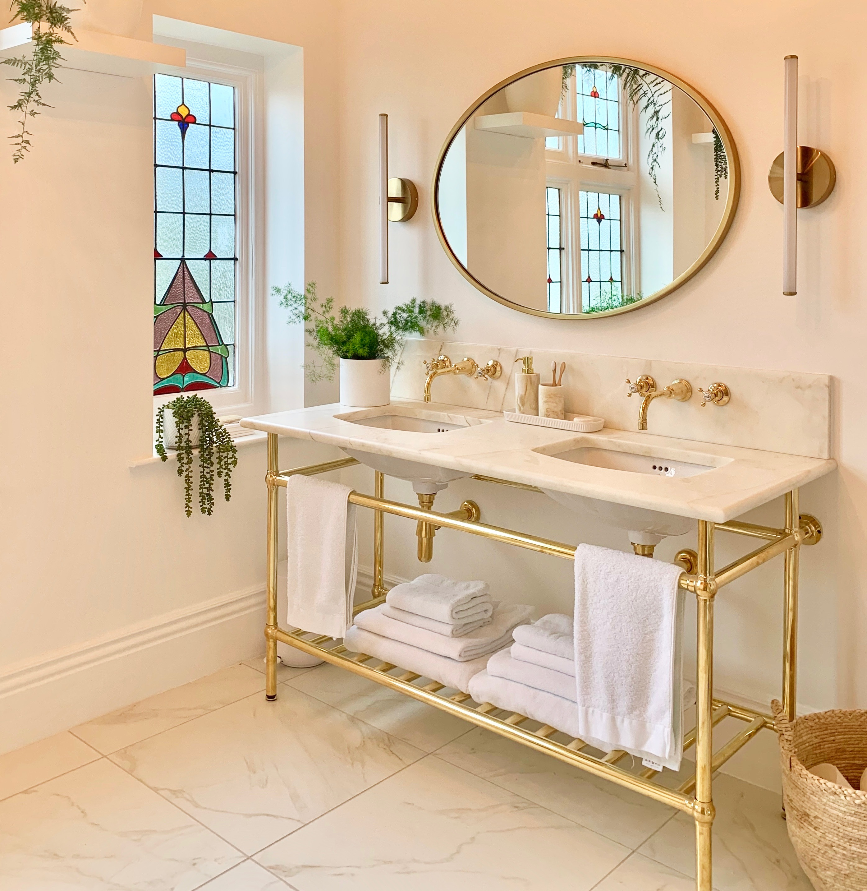 bathroom with marble floor tiles marble double vanity unit polisged brass basin taps bathroom mirror